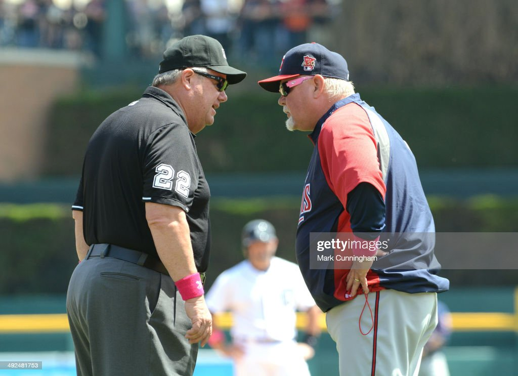 Manager Ron Gardenhire of the Minnesota Twins talks with major league umpire Joe West during the game against the Detroit Tigers at Comerica Park on...