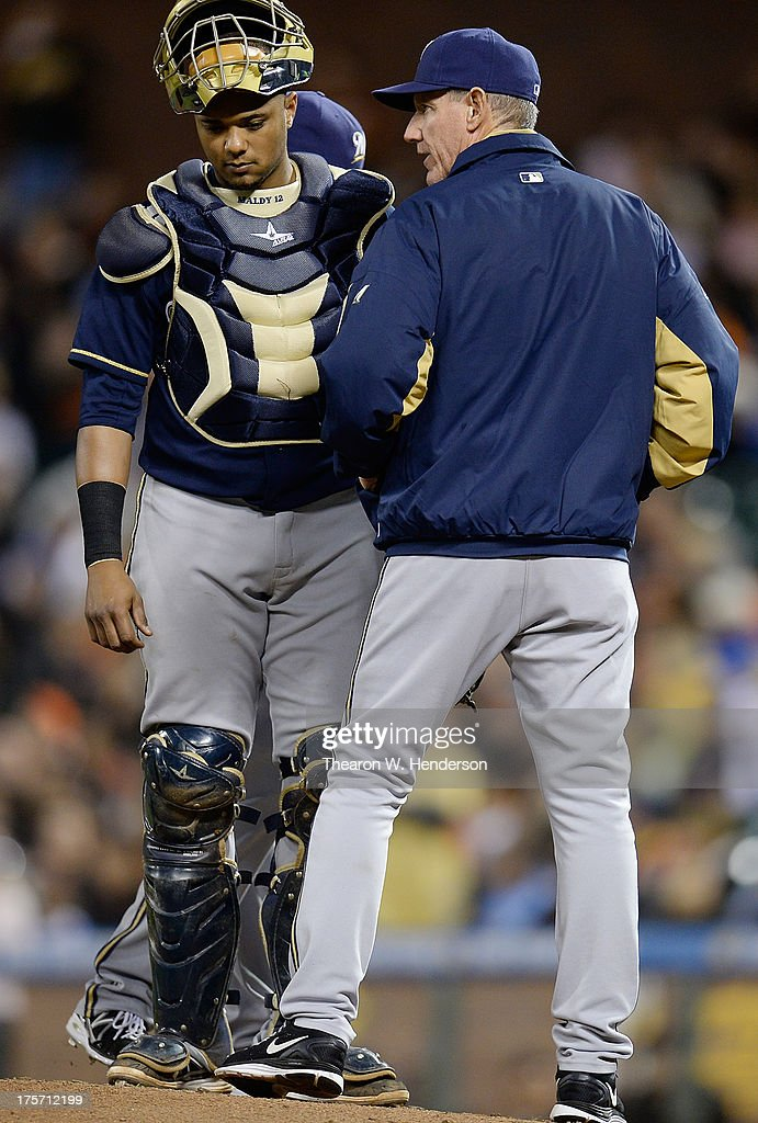Manager <a gi-track='captionPersonalityLinkClicked' href=/galleries/search?phrase=Ron+Roenicke&family=editorial&specificpeople=835989 ng-click='$event.stopPropagation()'>Ron Roenicke</a> #10 of the Milwaukee Brewers stands on the mound talking with his catcher Martin Maldonado #12 after making a pitching change in the seventh inning against the San Francisco Giants at AT&T Park on August 6, 2013 in San Francisco, California.