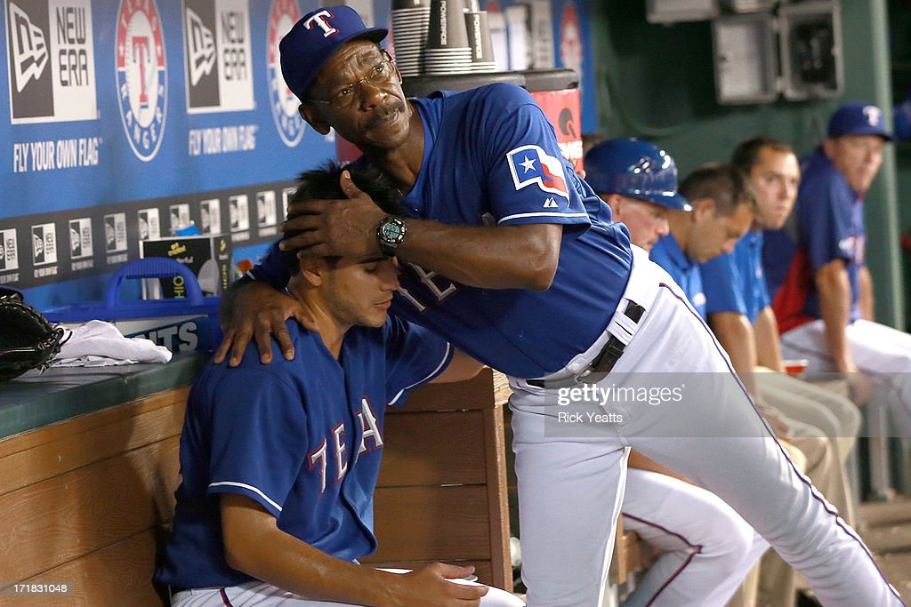 Manager <a gi-track='captionPersonalityLinkClicked' href=/galleries/search?phrase=Ron+Washington&family=editorial&specificpeople=225012 ng-click='$event.stopPropagation()'>Ron Washington</a> #38 congratulates Martin Perez #33 of the Texas Rangers after being relieved in the seventh inning during the game against the Cincinnati Reds at Rangers Ballpark in Arlington on June 28, 2013 in Arlington, Texas.