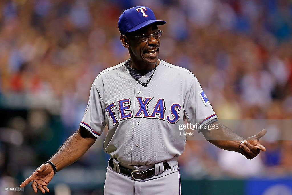 Manager <a gi-track='captionPersonalityLinkClicked' href=/galleries/search?phrase=Ron+Washington&family=editorial&specificpeople=225012 ng-click='$event.stopPropagation()'>Ron Washington</a> #38 of the Texas Rangers argues a call against the Tampa Bay Rays during the game at Tropicana Field on September 8, 2012 in St. Petersburg, Florida.