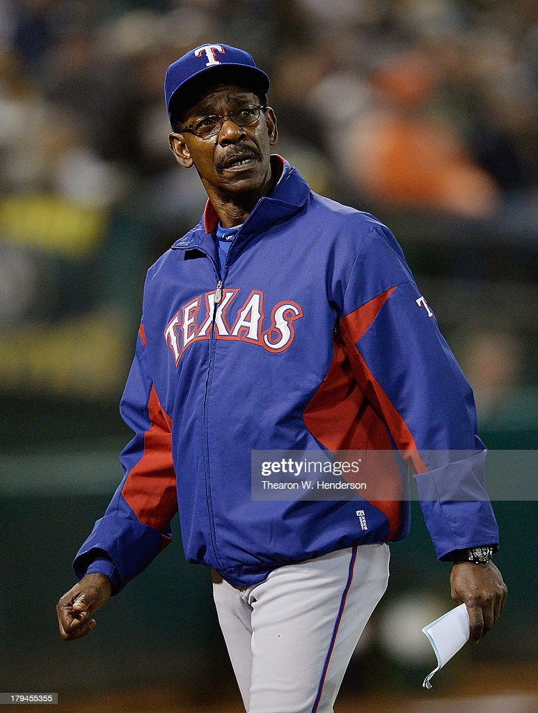 Manager <a gi-track='captionPersonalityLinkClicked' href=/galleries/search?phrase=Ron+Washington&family=editorial&specificpeople=225012 ng-click='$event.stopPropagation()'>Ron Washington</a> #38 of the Texas Rangers looking up at the scoreboard walks back to the dugout after making line-up changes with the umpire during the eighth inning against the Oakland Athletics at O.co Coliseum on September 3, 2013 in Oakland, California.