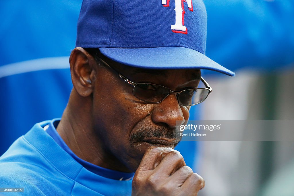Manager Ron Washington #38 of the Texas Rangers waits in the dugout in the first inning of their game against the Houston Astros at Minute Maid Park on May 14, 2014 in Houston, Texas.