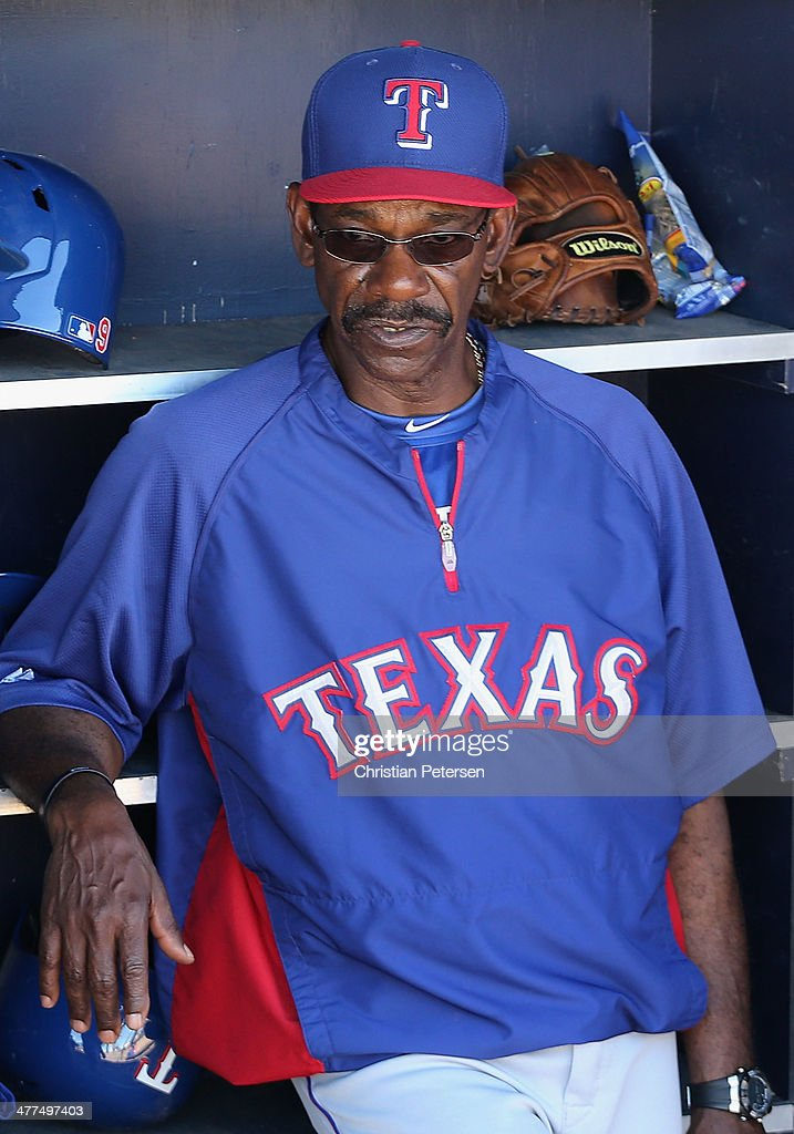 Manager <a gi-track='captionPersonalityLinkClicked' href=/galleries/search?phrase=Ron+Washington&family=editorial&specificpeople=225012 ng-click='$event.stopPropagation()'>Ron Washington</a> #38 of the Texas Rangers watches from the dugout during the spring training game against the Seattle Mariners at Peoria Stadium on March 9, 2014 in Peoria, Arizona.