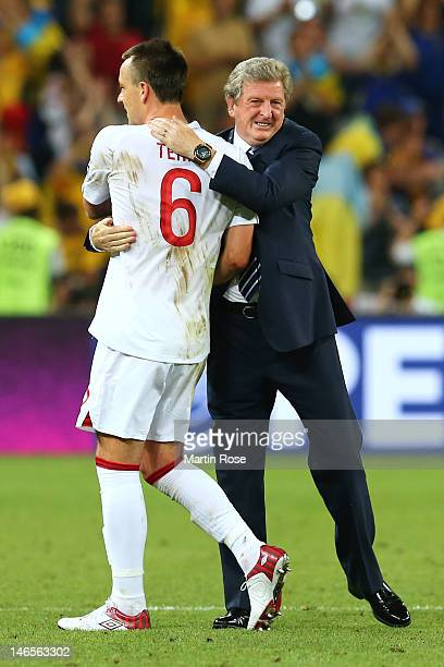 Manager Roy Hodgson of England shakes hands with John Terry as they celebrate victory and progress to the quarterfinals during the UEFA EURO 2012...