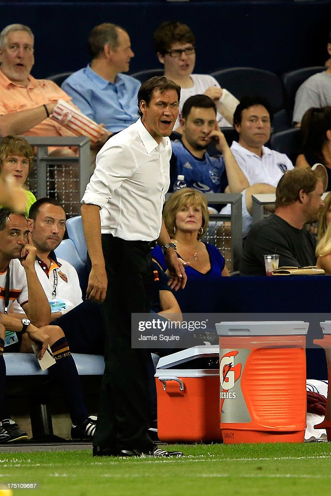 Manager <a gi-track='captionPersonalityLinkClicked' href=/galleries/search?phrase=Rudi+Garcia&family=editorial&specificpeople=4444731 ng-click='$event.stopPropagation()'>Rudi Garcia</a> of AS Roma coaches during the 2013 Major League Soccer All Star Game against the MLS All-Stars at Sporting Park on July 31, 2013 in Kansas City, Kansas.