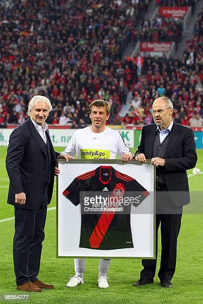 Manager Rudi Voeller and chairmann Wolfgang Holzhaeuser of Leverkusen hand out a jersey to Bernd Schneider of Schnix All Stars before the Bernd...