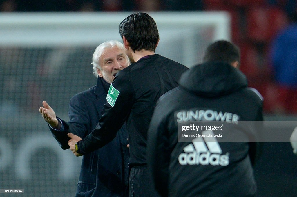 Manager <a gi-track='captionPersonalityLinkClicked' href=/galleries/search?phrase=Rudi+Voeller&family=editorial&specificpeople=225089 ng-click='$event.stopPropagation()'>Rudi Voeller</a> of Leverkusen reacts to referee Deniz Aytekin after the Bundesliga match between Bayer 04 Leverkusen and Borussia Dortmund at BayArena on February 3, 2013 in Leverkusen, Germany.