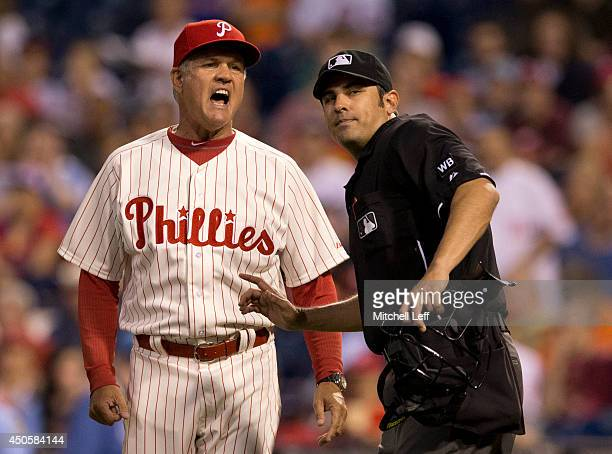Manager Ryne Sandberg of the Philadelphia Phillies is ejected in the top of the sixth inning by home plate umpire Mark Ripperger after Phillies...
