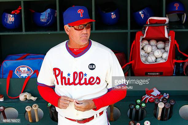 Manager Ryne Sandberg of the Philadelphia Phillies looks on from the dugout before the start of a game against the Washington Nationals at Citizens...