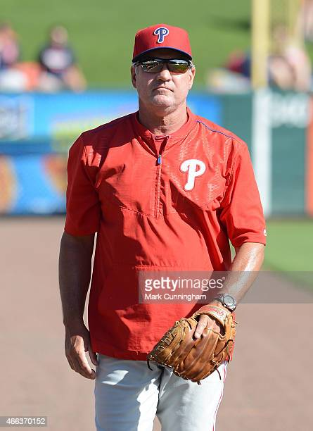 Manager Ryne Sandberg of the Philadelphia Phillies looks on prior to the Spring Training game against the Detroit Tigers at Joker Marchant Stadium on...