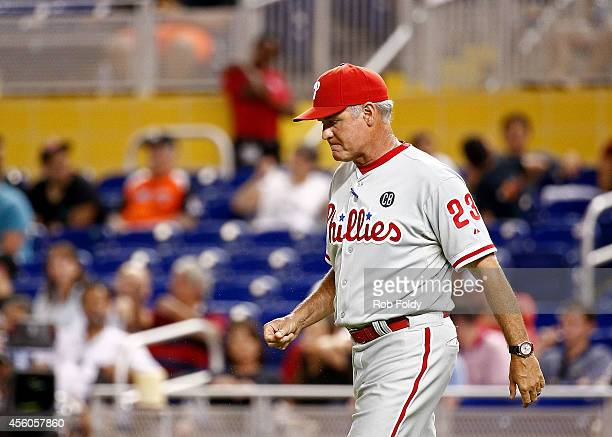 Manager Ryne Sandberg of the Philadelphia Phillies walks out to the mound during the ninth inning of the game against the Miami Marlins at Marlins...