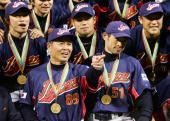 Manager Sadaharu Oh and Ichiro Suzuki of Team Japan celebrate after defeating Team Cuba in the Final game of the World Baseball Classic at Petco Park...