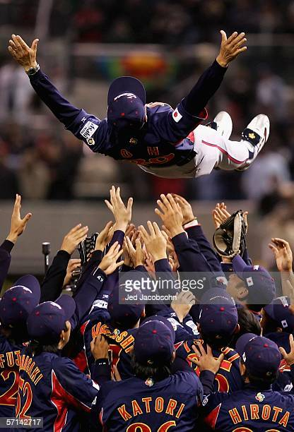 Manager Sadaharu Oh of Team Japan is thrown up into the air by teammates after defeating Team Cuba in the Final game of the World Baseball Classic at...