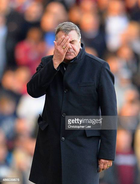 Manager Sam Allardyce of West Ham United rubs his face and looks dejected during the Barclays Premier League match between West Ham United and...