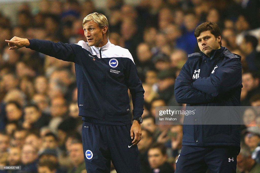 Manager Sami Hyypia of Brighton and Manager Mauricio Pochettino of Spurs on the touchline during the Capital One Cup Fourth Round match Tottenham...