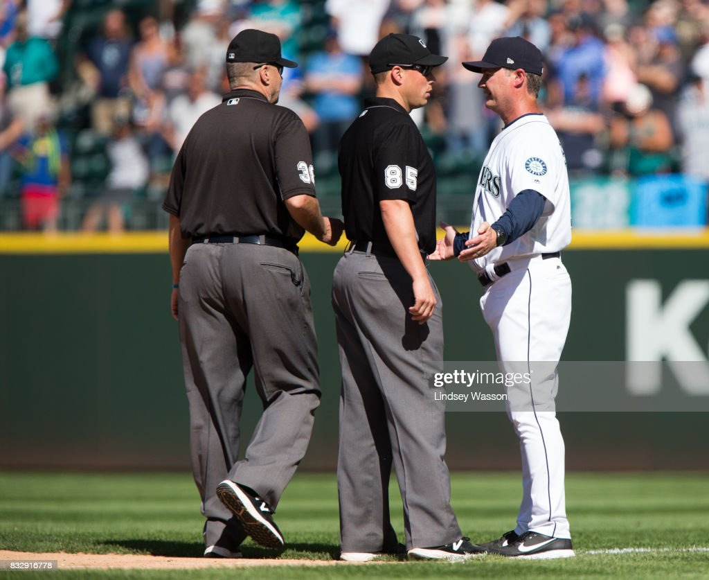 Manager Scott Servais of the Seattle Mariners argues the call that Chris Davis of the Baltimore Orioles was hit by a pitch with first base umpire Stu Scheurwater #85, and is ejected from the game in the ninth inning at Safeco Field on August 16, 2017 in Seattle, Washington.