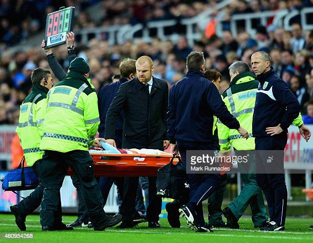 Manager Sean Dyche of Burnley looks on as Kevin Long of Burnley is stretchered off injured during the Barclays Premier League match between Newcastle...