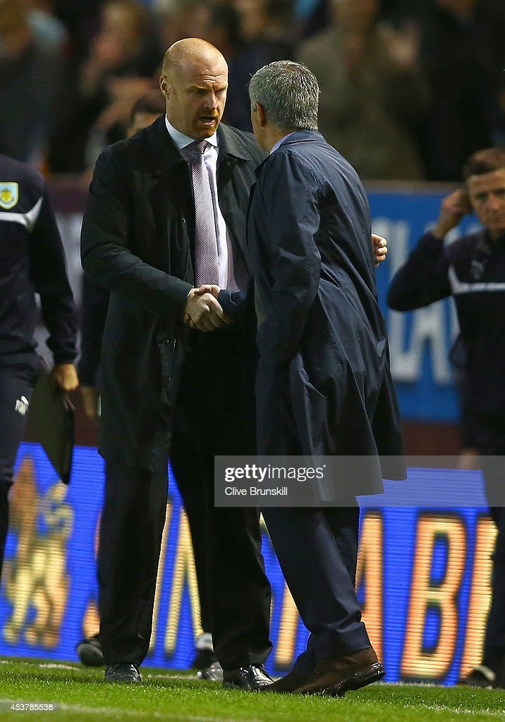 Manager <a gi-track='captionPersonalityLinkClicked' href=/galleries/search?phrase=Sean+Dyche&family=editorial&specificpeople=886017 ng-click='$event.stopPropagation()'>Sean Dyche</a> of Burnley shakes hands with Manager Jose Mourinho of Chelsea after the Barclays Premier League match between Burnley and Chelsea at Turf Moor on August 18, 2014 in Burnley, England.