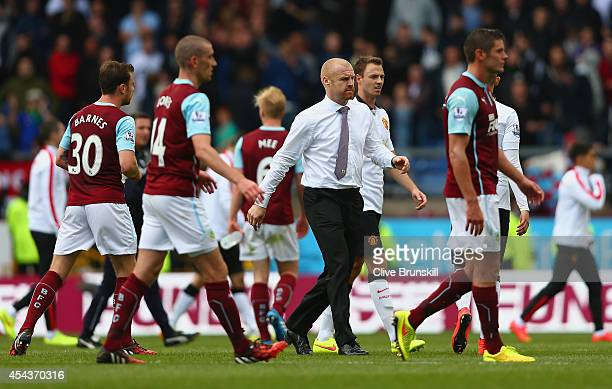 Manager Sean Dyche of Burnley walks across the pitch at the final whistle during the Barclays Premier League match between Burnley and Manchester...