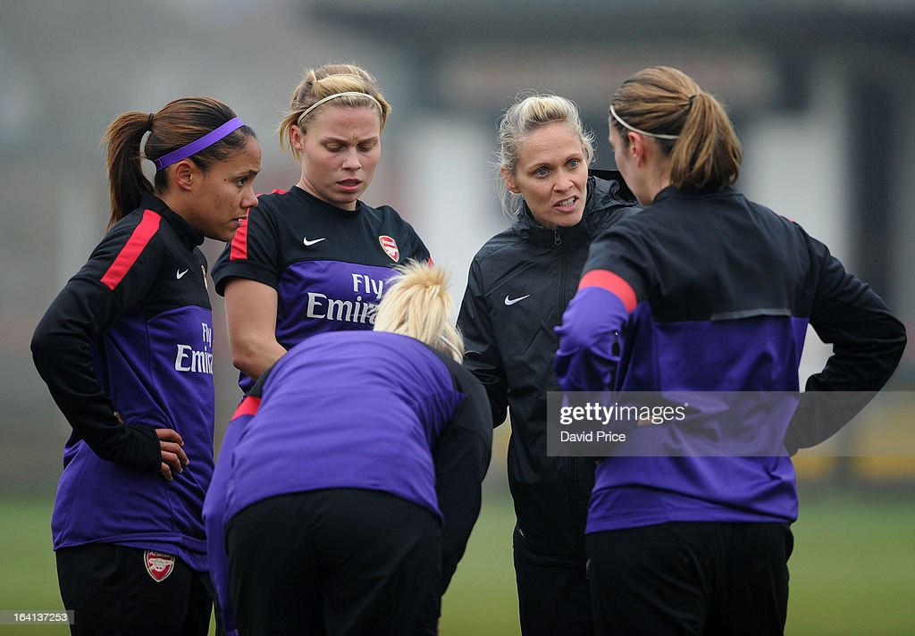 Manager Shelley Kerr (2nd R) of Arsenal Ladies FC speaks to (L-R) Alex Scott, Gilly Flaherty, Steph Houghton and Ciara Grant before the Women's Champions League Quarter Final match between Arsenal Ladies FC and ASD Torres CF at Meadow Park on March 20, 2013 in Borehamwood, United Kingdom.