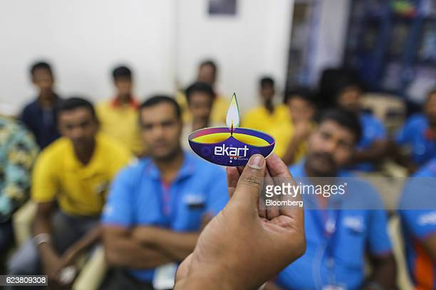 A manager shows a Diwali Ekart Logistics service gift for customers during a briefing at the Flipkart Online Services Pvt office in the Jayaprakash...