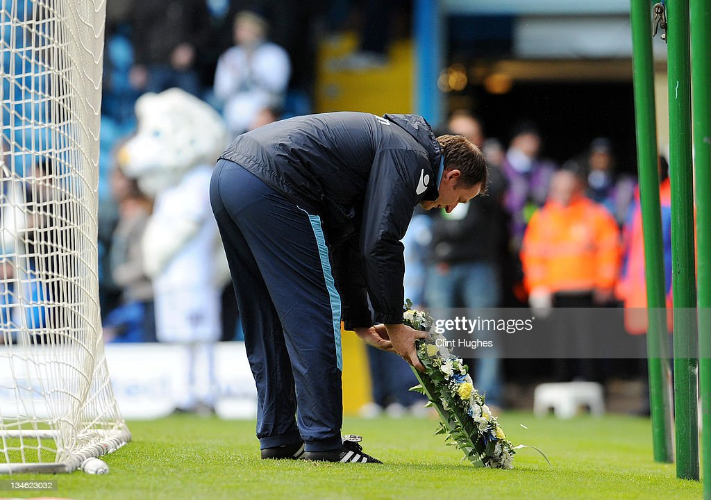 Manager Simon Grayson of Leeds lays a wreath prior to kick off during the npower Championship match between Leeds United and Millwall at Elland Road on December 03, 2011 in Leeds, England.
