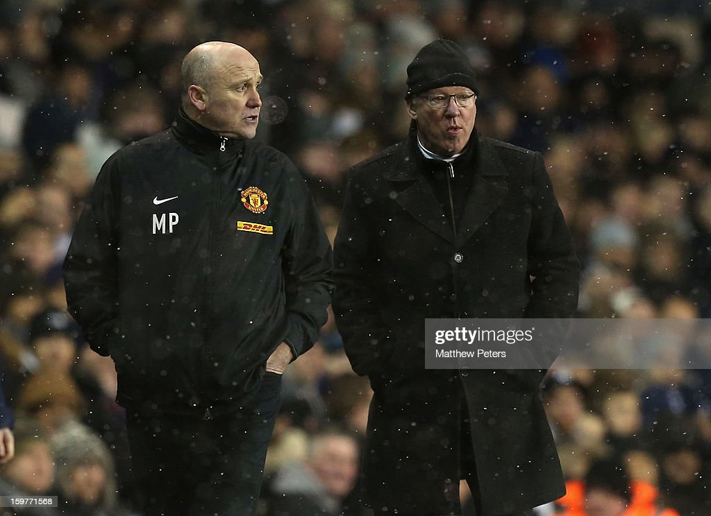 Manager Sir Alex Ferguson (R) and Assistant Manager Mike Phelan of Manchester United watch from the touchline during the Barclays Premier League match between Tottenham Hotspur and Manchester United at White Hart Lane on January 20, 2013 in London, England.