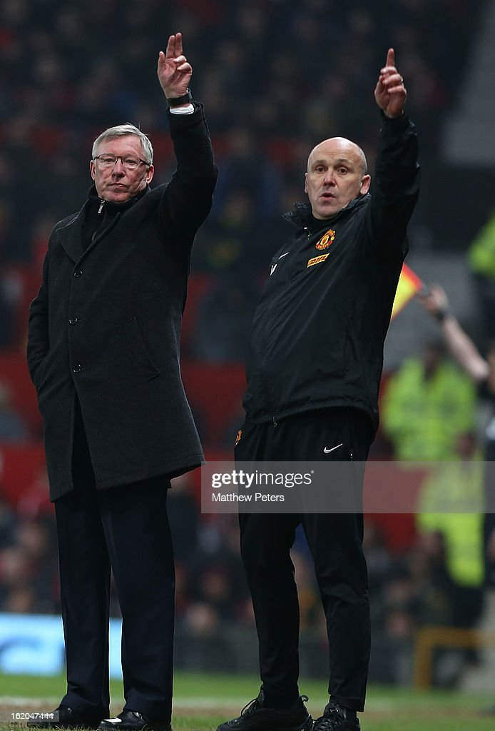 Manager Sir Alex Ferguson (L) and assistant manager Mike Phelan of Manchester United gesture from the touchline during the FA Cup Fifth Round match between Manchester United and Reading at Old Trafford on February 18, 2013 in Manchester, England.