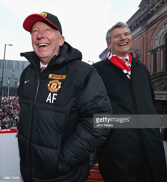 Manager Sir Alex Ferguson and Chief Executive David Gill of Manchester United poses on their Barclays Premier League Trophy Parade through Manchester...