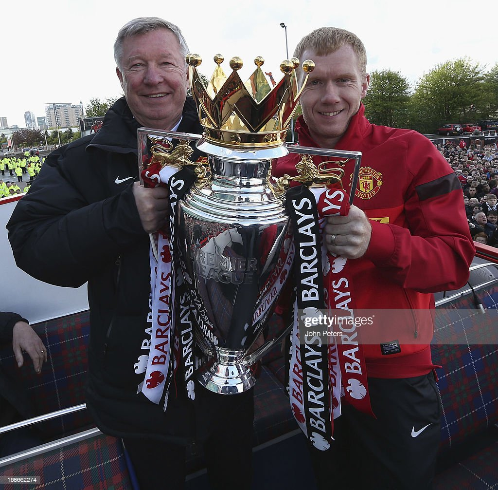 Manager Sir <a gi-track='captionPersonalityLinkClicked' href=/galleries/search?phrase=Alex+Ferguson&family=editorial&specificpeople=203067 ng-click='$event.stopPropagation()'>Alex Ferguson</a> and <a gi-track='captionPersonalityLinkClicked' href=/galleries/search?phrase=Paul+Scholes&family=editorial&specificpeople=171770 ng-click='$event.stopPropagation()'>Paul Scholes</a> pose with the Premier League trophy on their Barclays Premier League Trophy Parade through Manchester on May 13, 2013 in Manchester, England.