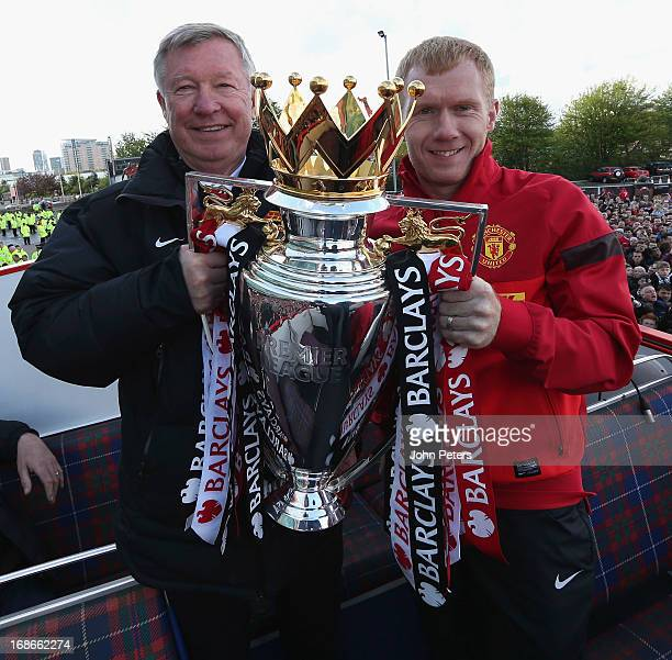 Manager Sir Alex Ferguson and Paul Scholes pose with the Premier League trophy on their Barclays Premier League Trophy Parade through Manchester on...
