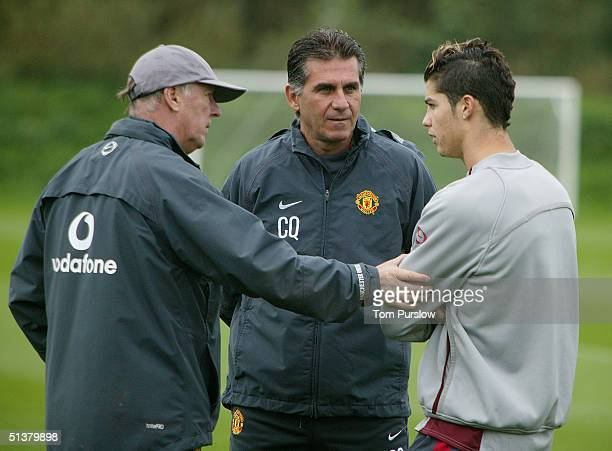 Manager Sir Alex Ferguson Assistant Manager Carlos Queiroz talk with Cristiano Ronaldo of Manchester United during a first team training session at...