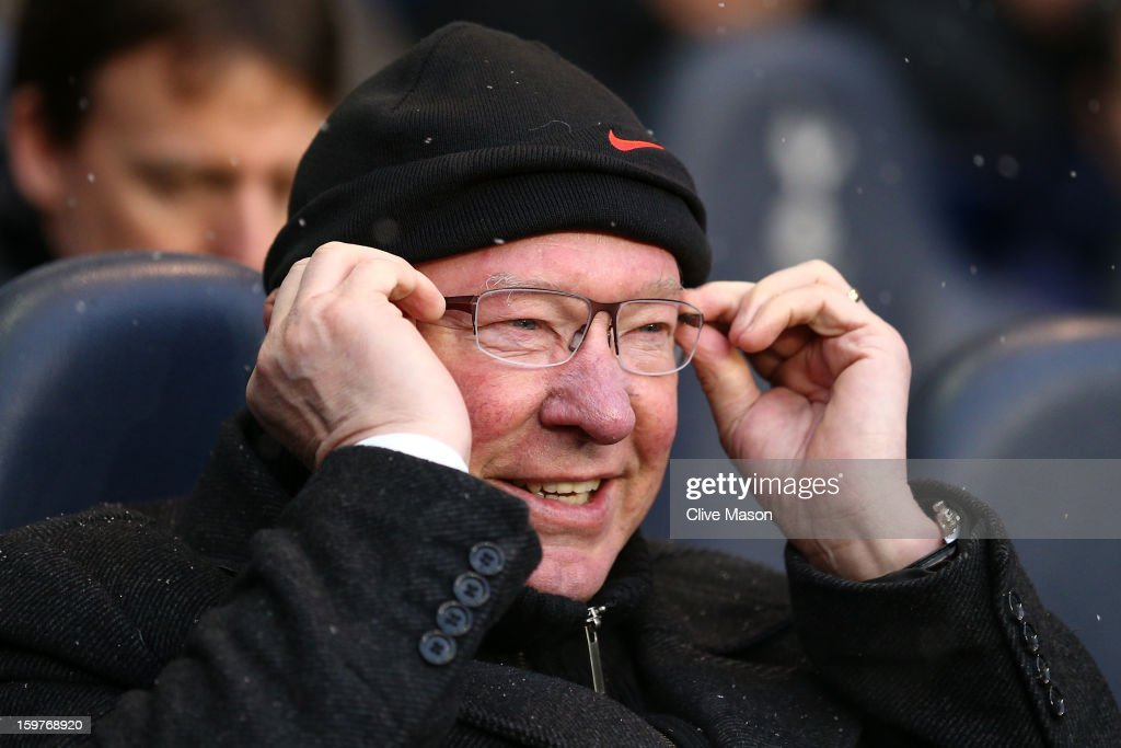 Manager Sir Alex Ferguson of Manchester United adjusts his glasses during the Barclays Premier League match between Tottenham Hotspur and Manchester United at White Hart Lane on January 20, 2013 in London, England.