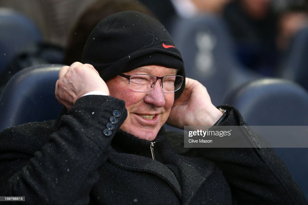 Manager Sir <a gi-track='captionPersonalityLinkClicked' href=/galleries/search?phrase=Alex+Ferguson&family=editorial&specificpeople=203067 ng-click='$event.stopPropagation()'>Alex Ferguson</a> of Manchester United adjusts his hat during the Barclays Premier League match between Tottenham Hotspur and Manchester United at White Hart Lane on January 20, 2013 in London, England.