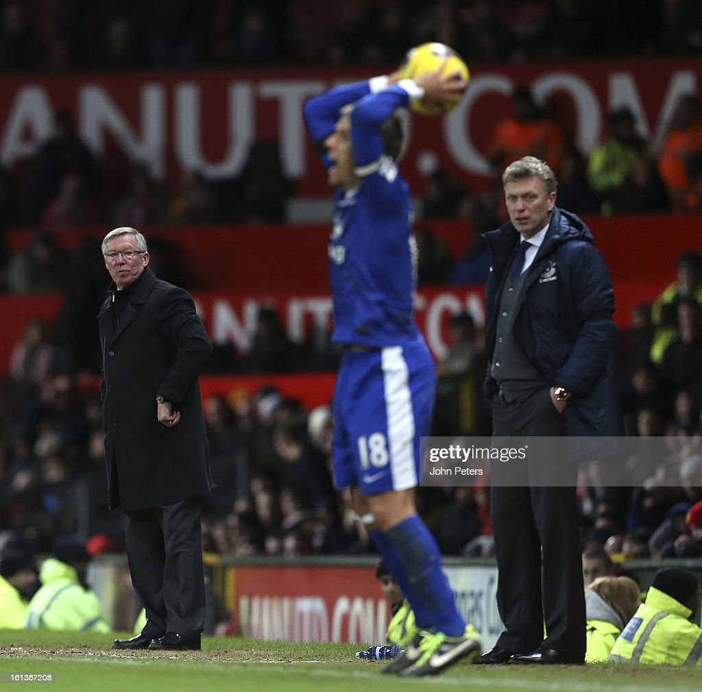 Manager Sir Alex Ferguson of Manchester United and David Moyes of Everton watch from the touchline during the Barclays Premier League match between Manchester United and Everton at Old Trafford on February 10, 2013 in Manchester, England.