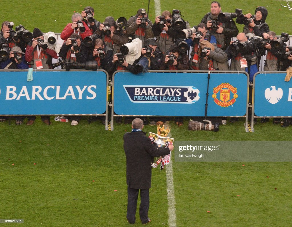 Manager Sir <a gi-track='captionPersonalityLinkClicked' href=/galleries/search?phrase=Alex+Ferguson&family=editorial&specificpeople=203067 ng-click='$event.stopPropagation()'>Alex Ferguson</a> of Manchester United celebrates with the Premier League trophy after the Barclays Premier League match between Manchester United and Swansea City at Old Trafford on May 12, 2013 in Manchester, England.