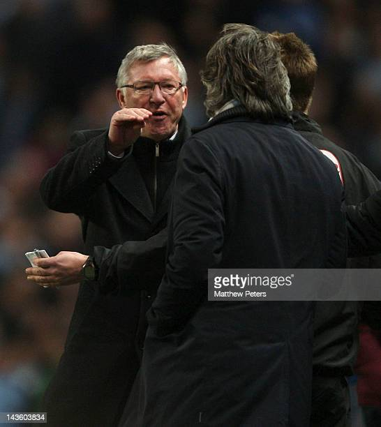 Manager Sir Alex Ferguson of Manchester United clashes with manager Roberto Mancini of Manchester City during the Barclays Premier League match...