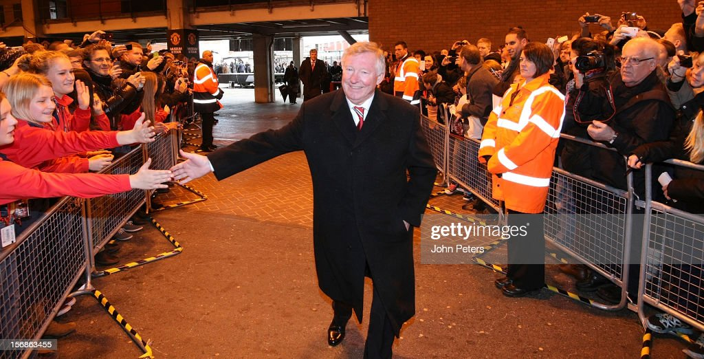 Manager Sir <a gi-track='captionPersonalityLinkClicked' href=/galleries/search?phrase=Alex+Ferguson&family=editorial&specificpeople=203067 ng-click='$event.stopPropagation()'>Alex Ferguson</a> of Manchester United greets fans after the unveiling of a statue of himself of Manchester United at Old Trafford on November 23, 2012 in Manchester, England.