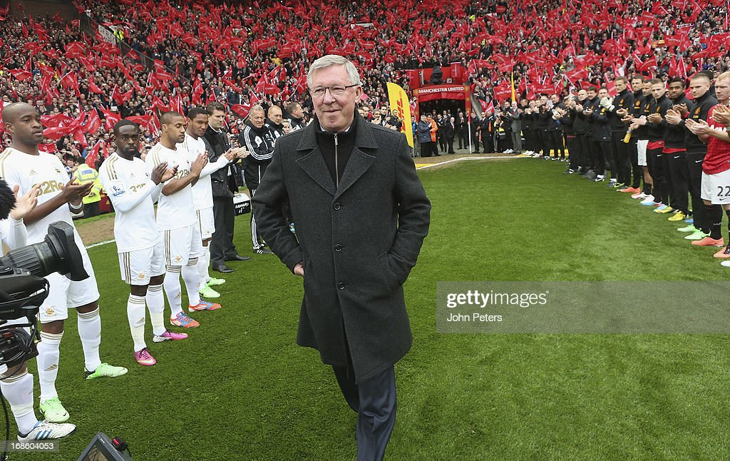Manager Sir <a gi-track='captionPersonalityLinkClicked' href=/galleries/search?phrase=Alex+Ferguson&family=editorial&specificpeople=203067 ng-click='$event.stopPropagation()'>Alex Ferguson</a> of Manchester United is given a guard of honour by both teams ahead of the Barclays Premier League match between Manchester United and Swansea at Old Trafford on May 12, 2013 in Manchester, England.
