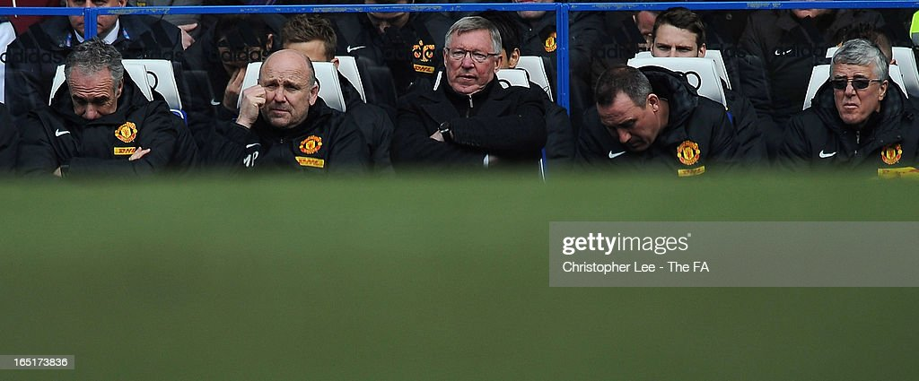Manager Sir <a gi-track='captionPersonalityLinkClicked' href=/galleries/search?phrase=Alex+Ferguson&family=editorial&specificpeople=203067 ng-click='$event.stopPropagation()'>Alex Ferguson</a> of Manchester United (C) looks dejected with his assistants during the FA Cup Sixth Round Replay match between Chelsea and Manchester United at Stamford Bridge on April 1, 2013 in London, England.