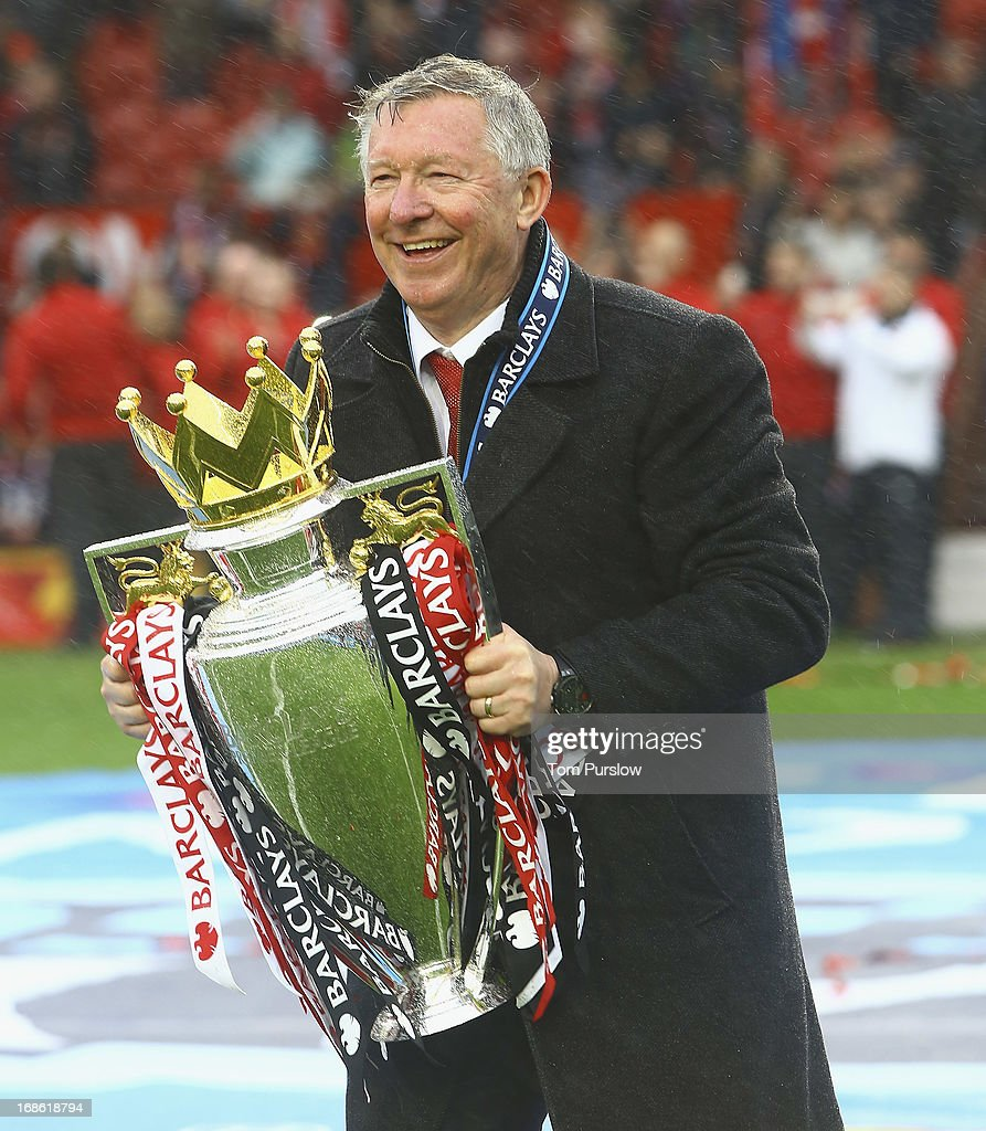 Manager Sir <a gi-track='captionPersonalityLinkClicked' href=/galleries/search?phrase=Alex+Ferguson&family=editorial&specificpeople=203067 ng-click='$event.stopPropagation()'>Alex Ferguson</a> of Manchester United poses with the Premier League trophy after the Barclays Premier League match between Manchester United and Swansea at Old Trafford on May 12, 2013 in Manchester, England.