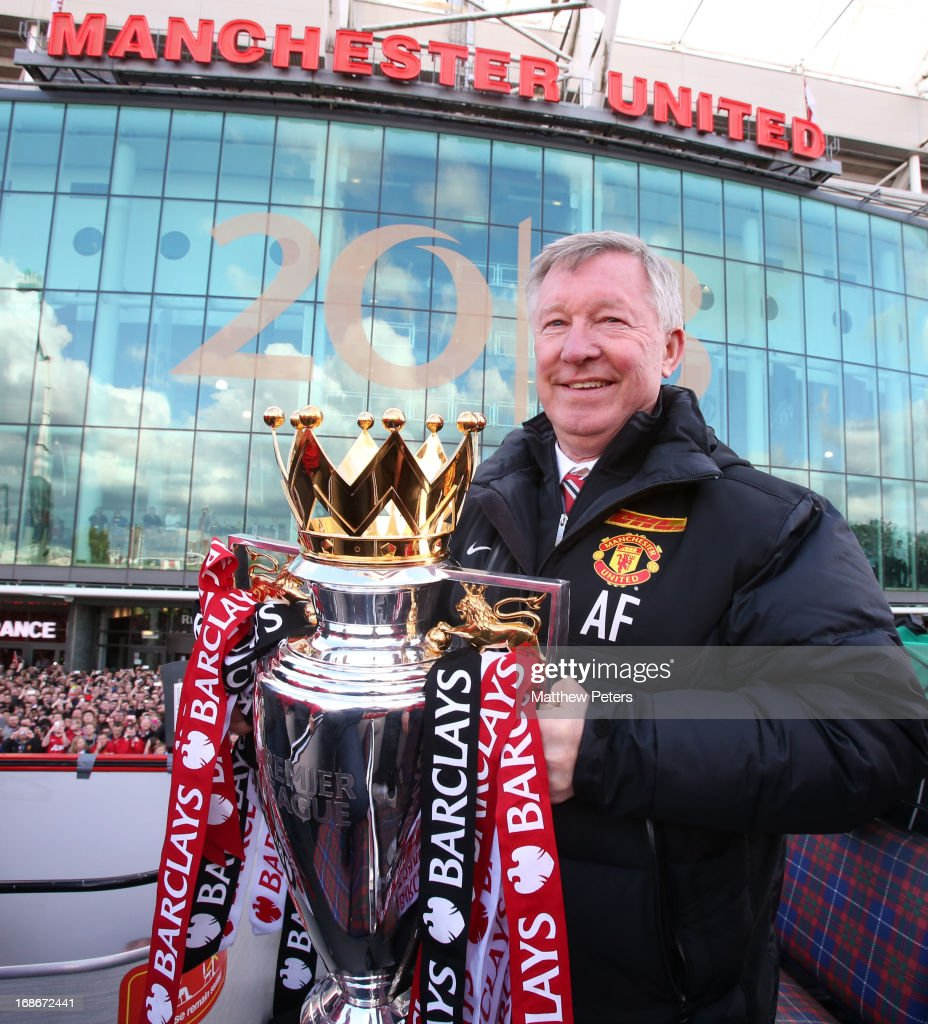 Manager Sir <a gi-track='captionPersonalityLinkClicked' href=/galleries/search?phrase=Alex+Ferguson&family=editorial&specificpeople=203067 ng-click='$event.stopPropagation()'>Alex Ferguson</a> of Manchester United poses with the Premier League trophy at the start of the Premier League trophy winners parade on May 13, 2013 in Manchester, England.