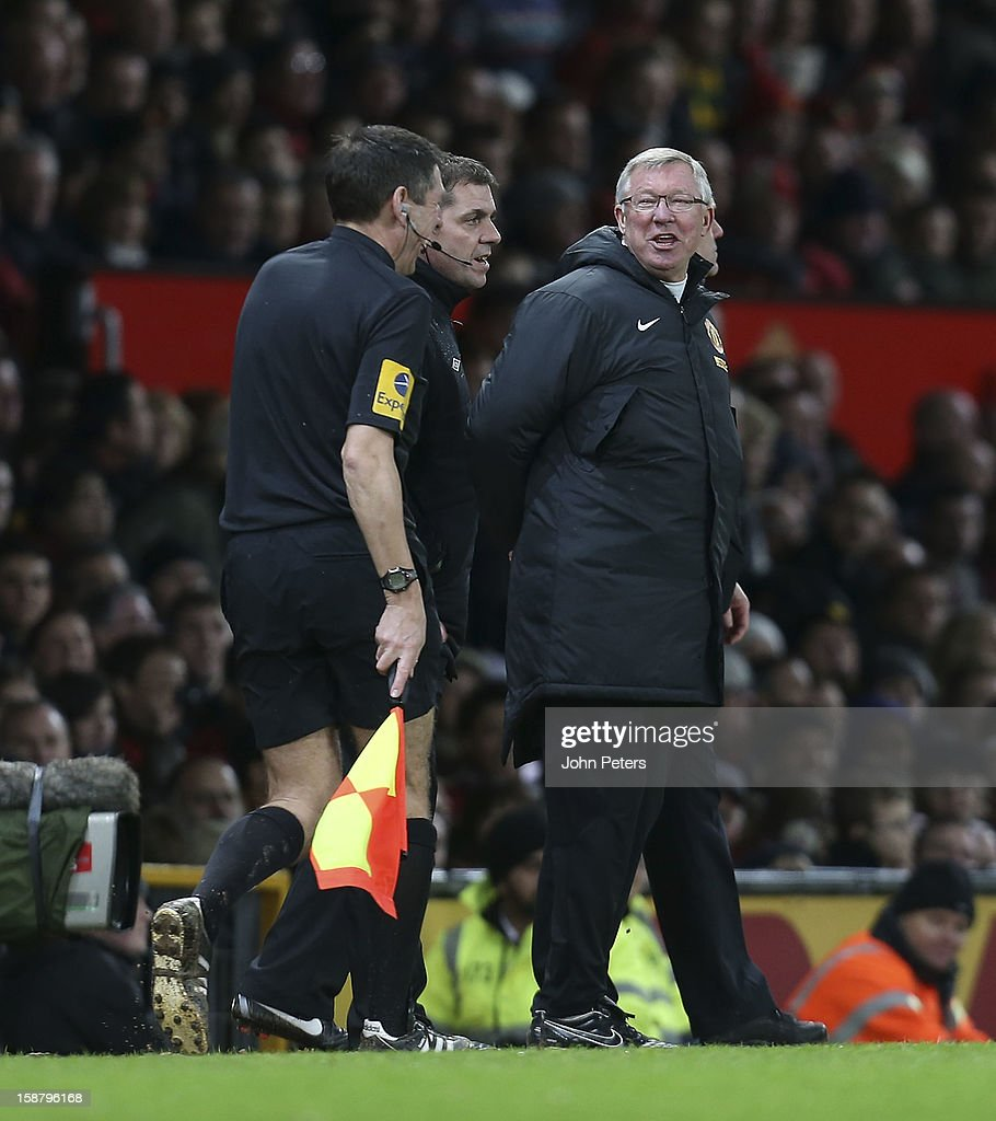 Manager Sir <a gi-track='captionPersonalityLinkClicked' href=/galleries/search?phrase=Alex+Ferguson&family=editorial&specificpeople=203067 ng-click='$event.stopPropagation()'>Alex Ferguson</a> of Manchester United shares a joke with assistant referee Andy Garratt during the Barclays Premier League match between Manchester United and West Bromwich Albion at Old Trafford on December 29, 2012 in Manchester, England.