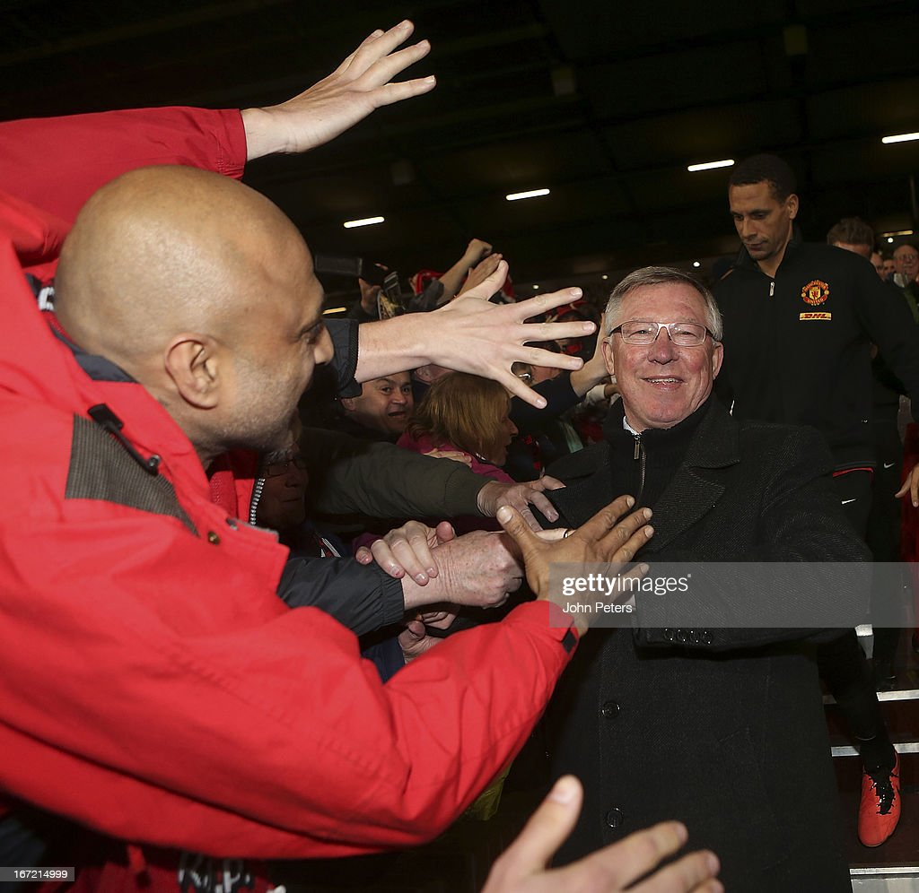 Manager Sir <a gi-track='captionPersonalityLinkClicked' href=/galleries/search?phrase=Alex+Ferguson&family=editorial&specificpeople=203067 ng-click='$event.stopPropagation()'>Alex Ferguson</a> of Manchester United squad celebrates after the Barclays Premier League match between Manchester United and Aston Villa at Old Trafford on April 22, 2013 in Manchester, England.