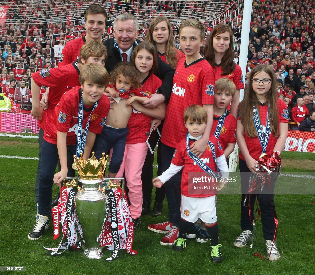 Manager Sir <a gi-track='captionPersonalityLinkClicked' href=/galleries/search?phrase=Alex+Ferguson&family=editorial&specificpeople=203067 ng-click='$event.stopPropagation()'>Alex Ferguson</a> of Manchester United squad celebrates with his grandchildren after the Barclays Premier League match between Manchester United and Swansea at Old Trafford on May 12, 2013 in Manchester, England.