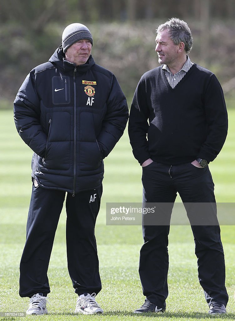 Manager Sir Alex Ferguson of Manchester United talks to Bryan Robson during a first team training session at Carrington Training Ground on April 26, 2013 in Manchester, England.