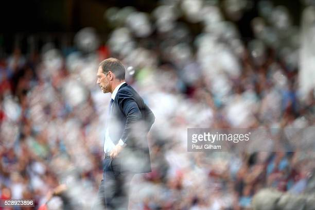 Manager Slaven Bilic of West Ham United looks on from the touchline during the Barclays Premier League match between West Ham United and Swansea City...