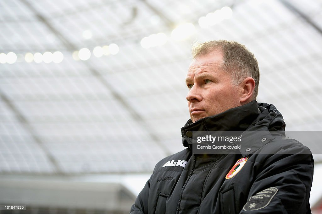 Manager Stefan Reuter of Augsburg looks on prior to the Bundesliga match between Bayer 04 Leverkusen and FC Augsburg at BayArena on February 16 2013...