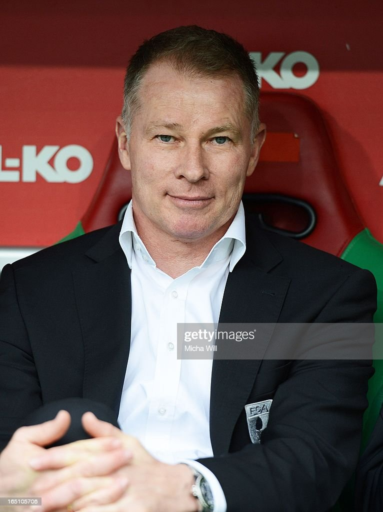 Manager Stefan Reuter of Augsburg looks on prior to the Bundesliga match between FC Augsburg and Hannover 96 at SGL Arena on March 30 2013 in...
