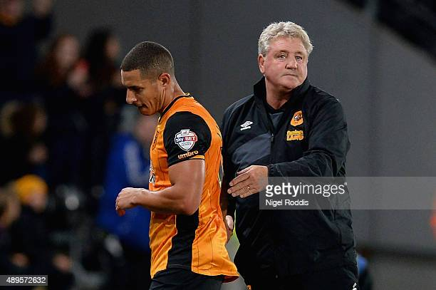Manager Steve Bruce of Hull City acknowledges Jake Livermore of Hull City as he is replaced during the Capital One Cup third round match between Hull...